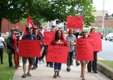 Rent vacant North End condos to local residents, demonstrators say