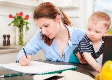 young-mother-studying-at-home-with-baby