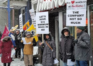 Fight for $15 and Fairness! activists rally at Tim Hortons in downtown Halifax