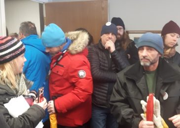 Postal workers and allies briefly occupy Andy Fillmore's constituency office