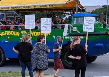 Photo view: Fight for 15 activists picket provincial Liberals' fundraiser